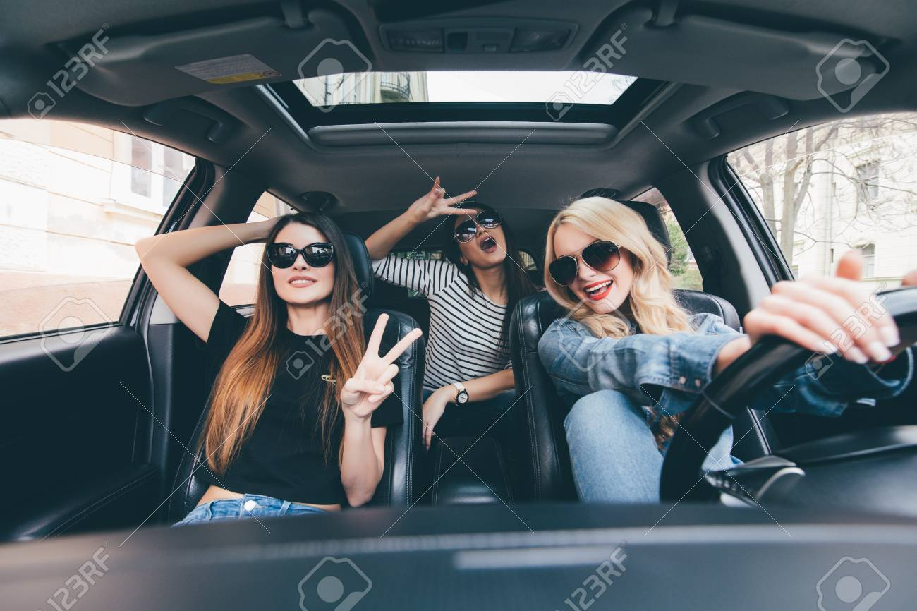 The Car Group >> Group Of Friends Having Fun On The Car Singing And Laughing