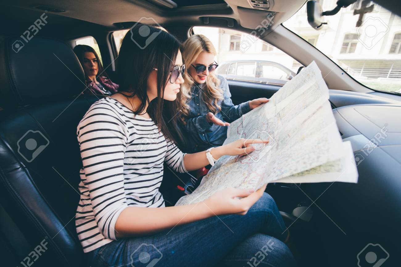 Women looking at map for directions while driving in car on car services, car trip, car history, car world bugatti veyron, car road map, car map parts, car driving map,