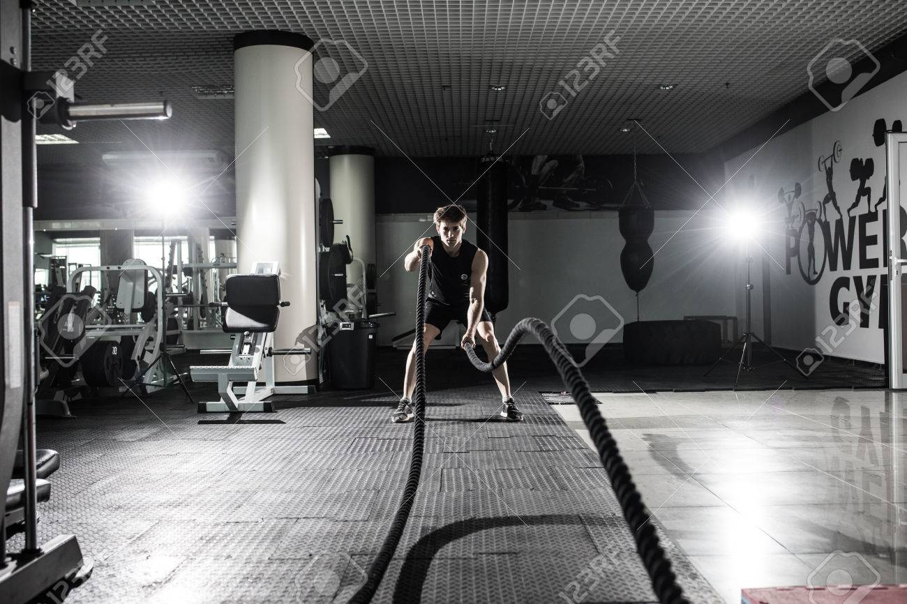 men with battle rope battle ropes exercise in the fitness gymmen with battle rope battle ropes exercise in the fitness gym crossfit stock photo