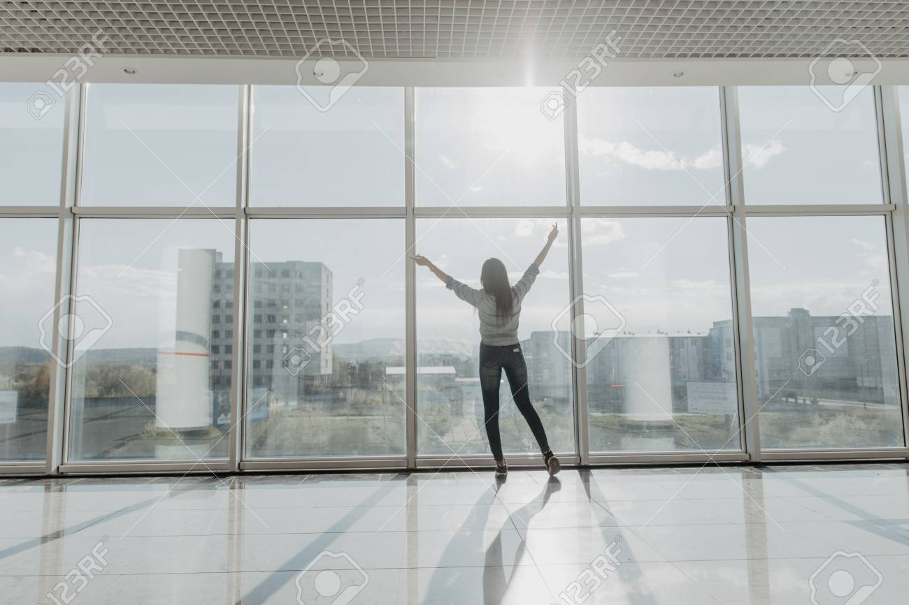 Confident Businesswoman Spreading Hands Standing At Office Window, Enjoying  Big City, Successful Entrepreneur Celebrating