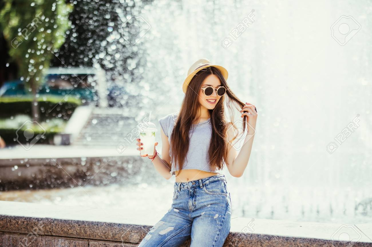 8e4f968e07f Stock Photo - Summer sunny lifestyle fashion portrait of young stylish  hipster woman walking on the street