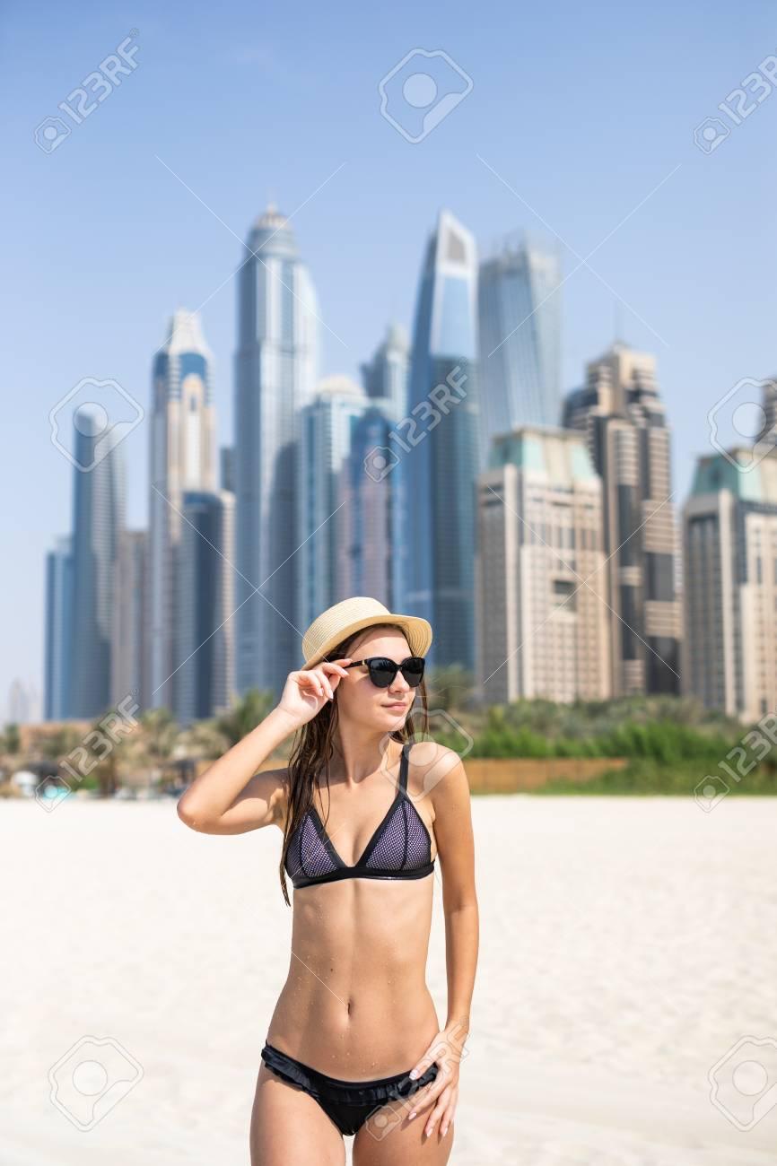 And Young Straw Hat Tan The In On Beach With Woman Dubai Bikini lFK1TJc