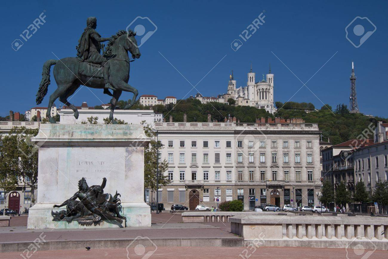 view of the equestrian statue of louis xiv and the basilica of notre dame de fourviere from place bellecour, in the center of lyon - 15437536