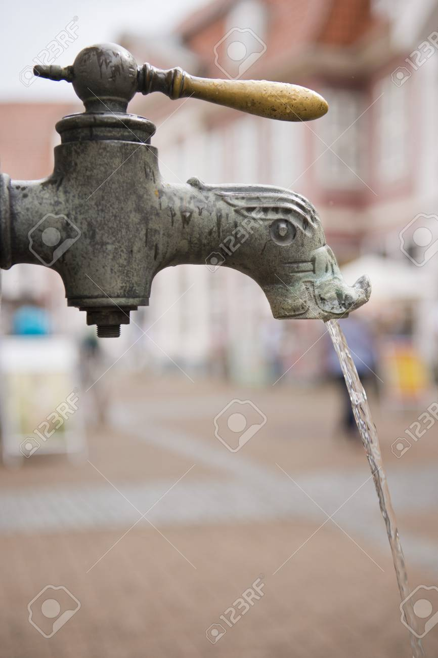 old fashioned metal  tap running Stock Photo - 22167894
