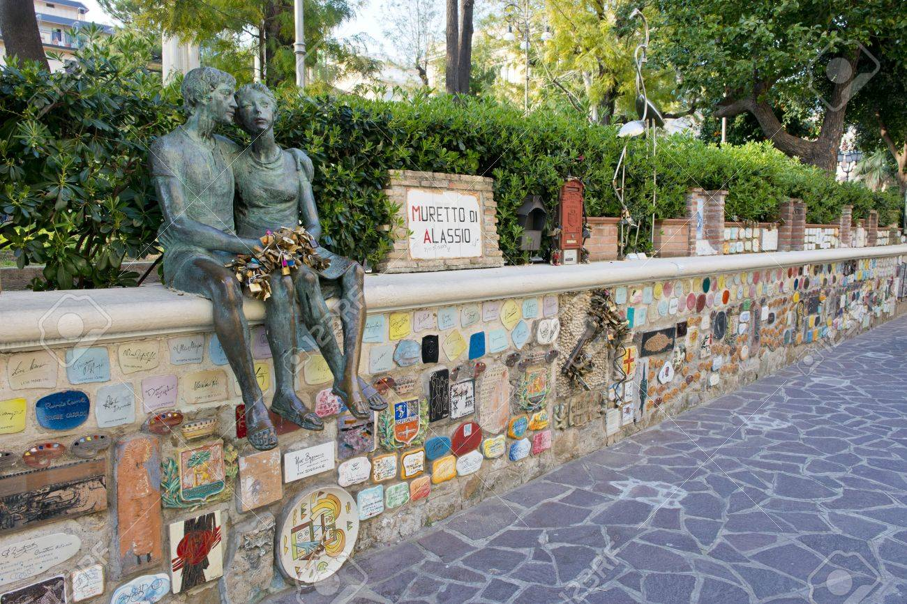 Muretto di Alassio, little wall with its plaques, symbol of Alassio in Liguria - 27061082