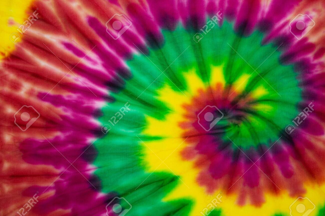 Tie Dye spiral rainbow color , abstract texture and background , reggae style . - 139271628