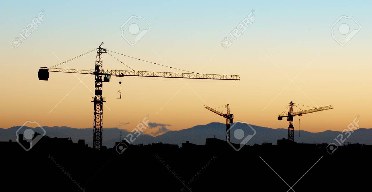 Building under construction - silhouette in the orange sunset Stock Photo - 662879
