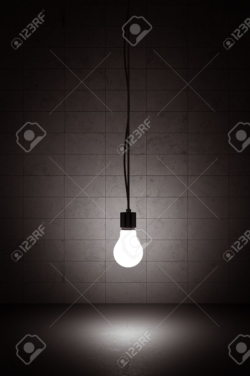 Hanging Pictures On Wire light bulb hanging on a wire with concrete background stock photo