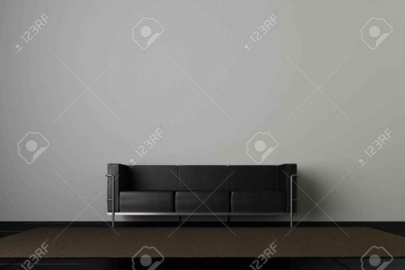 Leather couch in front of a grey wall Stock Photo - 13553589
