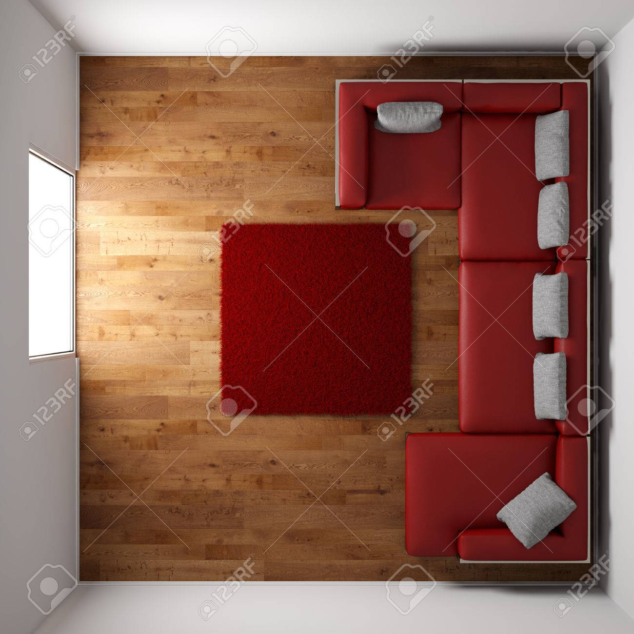 wooden floor texture with red leather couch and pillow top view stock photo
