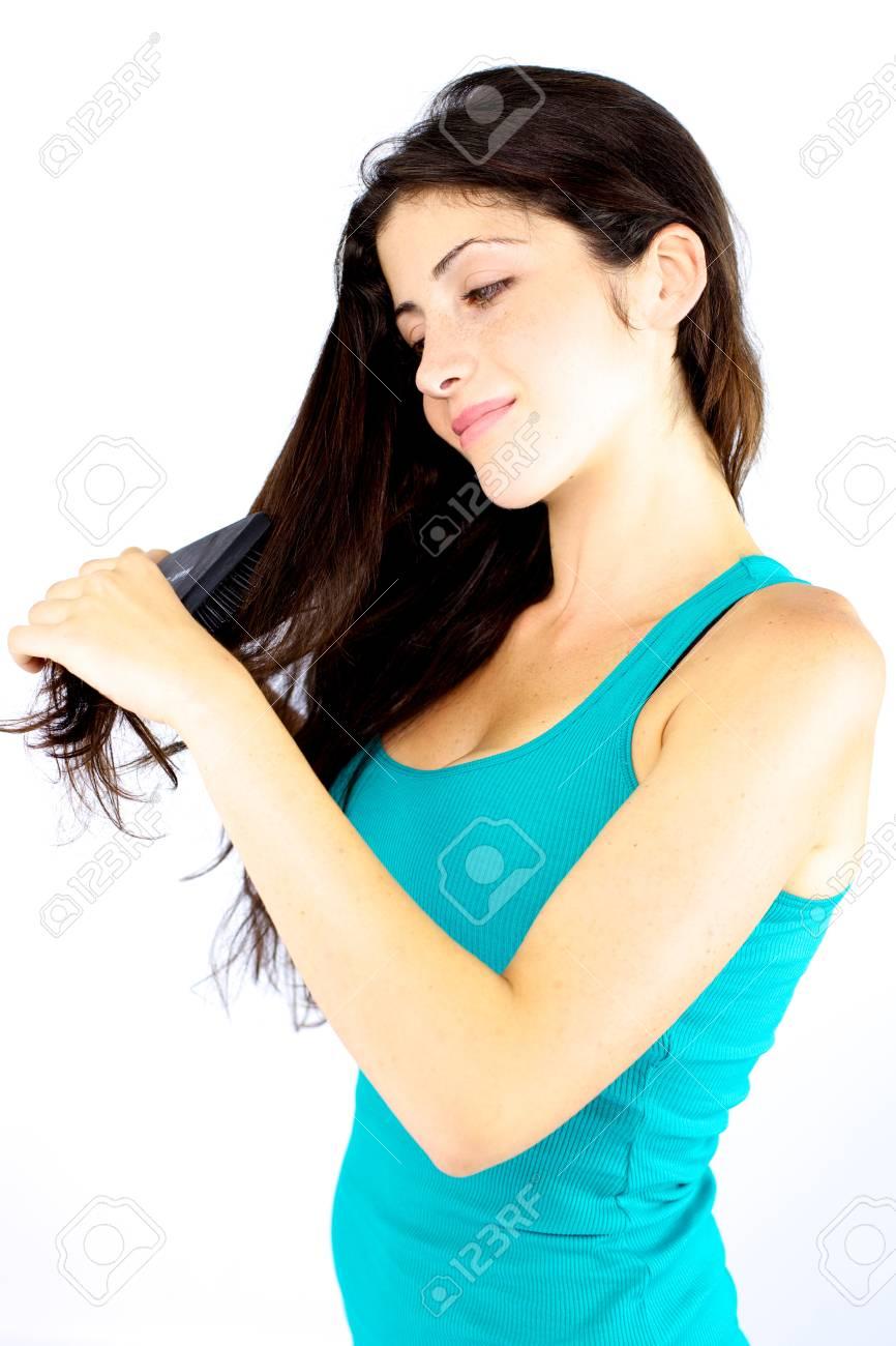 Smiling gorgeous girl brushing her very long hair Stock Photo - 15251760