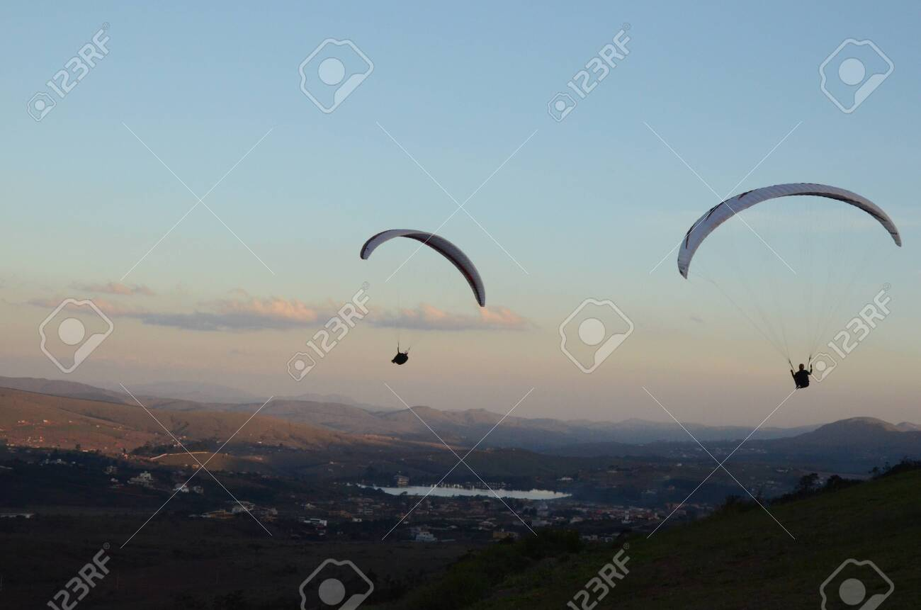 Two Paraglidings at sun set in Topo do Mundo (translated to Top of the World) in Minas Gerais - 151603444