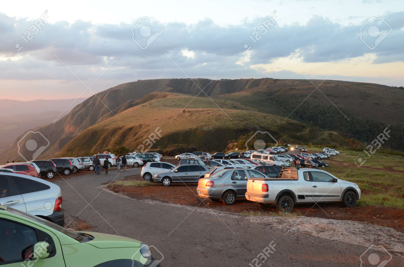 Cars lined up at sunset on a curve in Topo do Mundo (translated to Top of the World) in Minas Gerais - 151596706