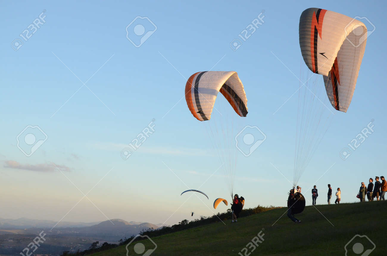 Two Paraglidings rising at sun set in Topo do Mundo (translated to Top of the World) in Minas Gerais - 151596709