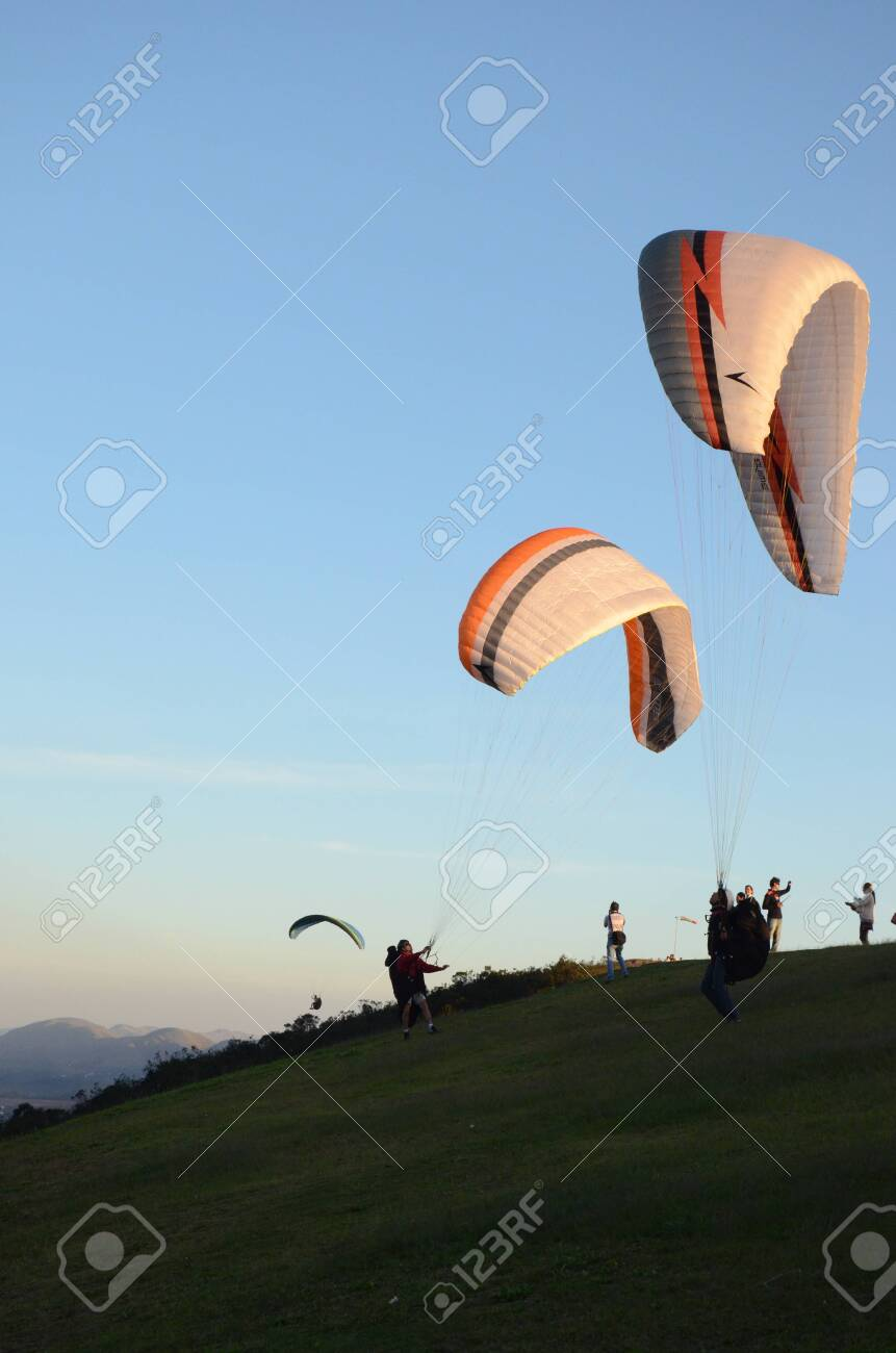 Two Paraglidings rising at sun set in Topo do Mundo (translated to Top of the World) in Minas Gerais - 151596713