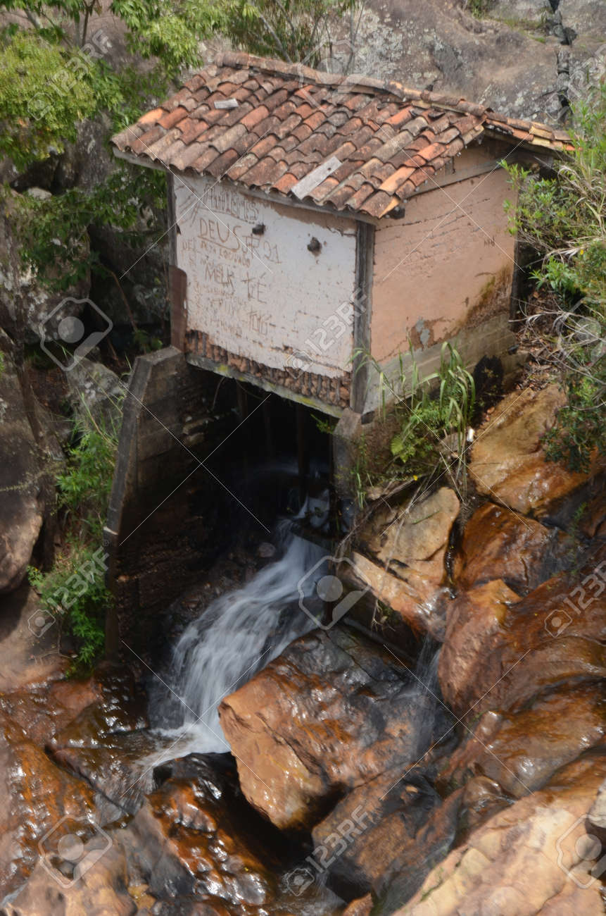 Watermill in Milho Verde in the state of Minas Gerais at Cachoeira do Moinho (translated to Watermill Waterfall) - 151845915