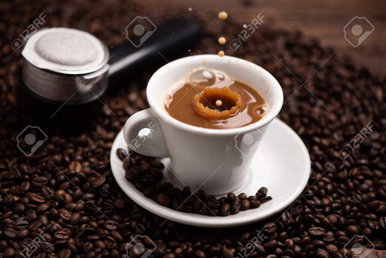 Drops of coffee splashing in a coffe milk, high speed close up - 145823040