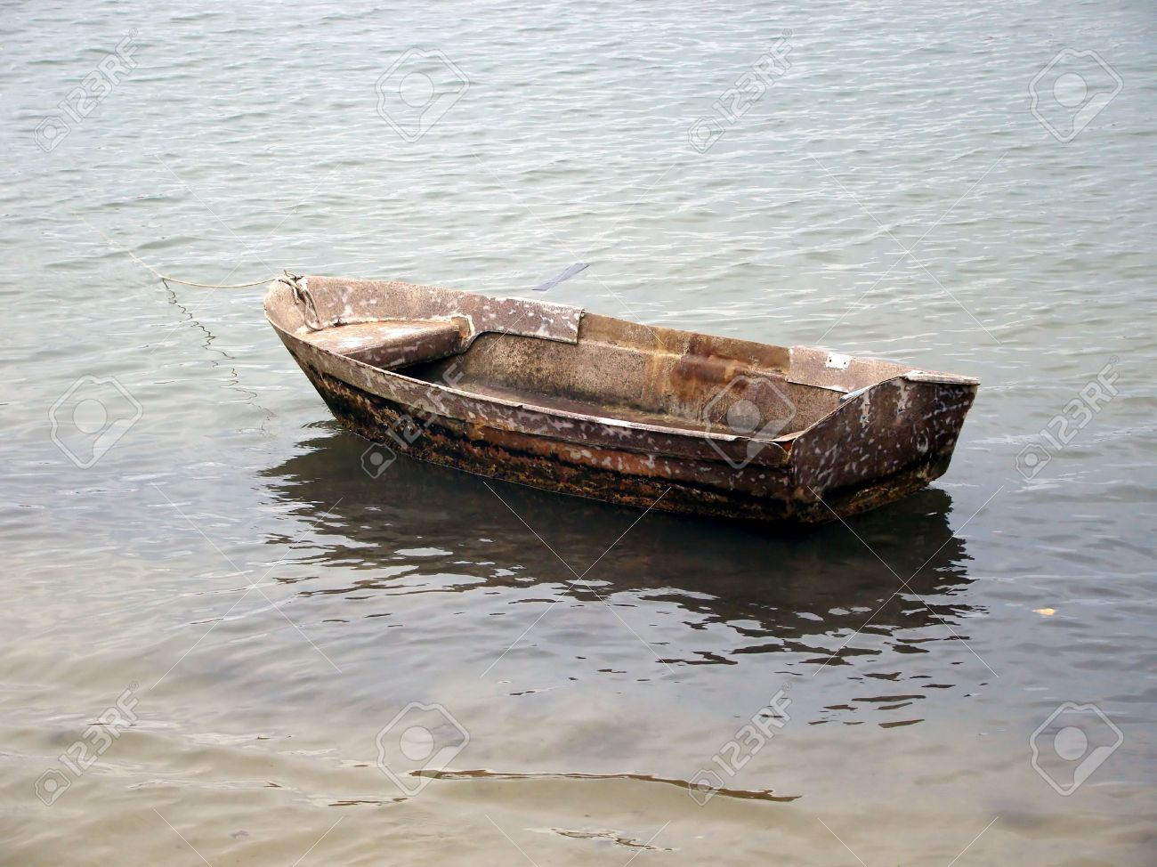 Small Wooden Boat Anchored On The Beach Stock Photo