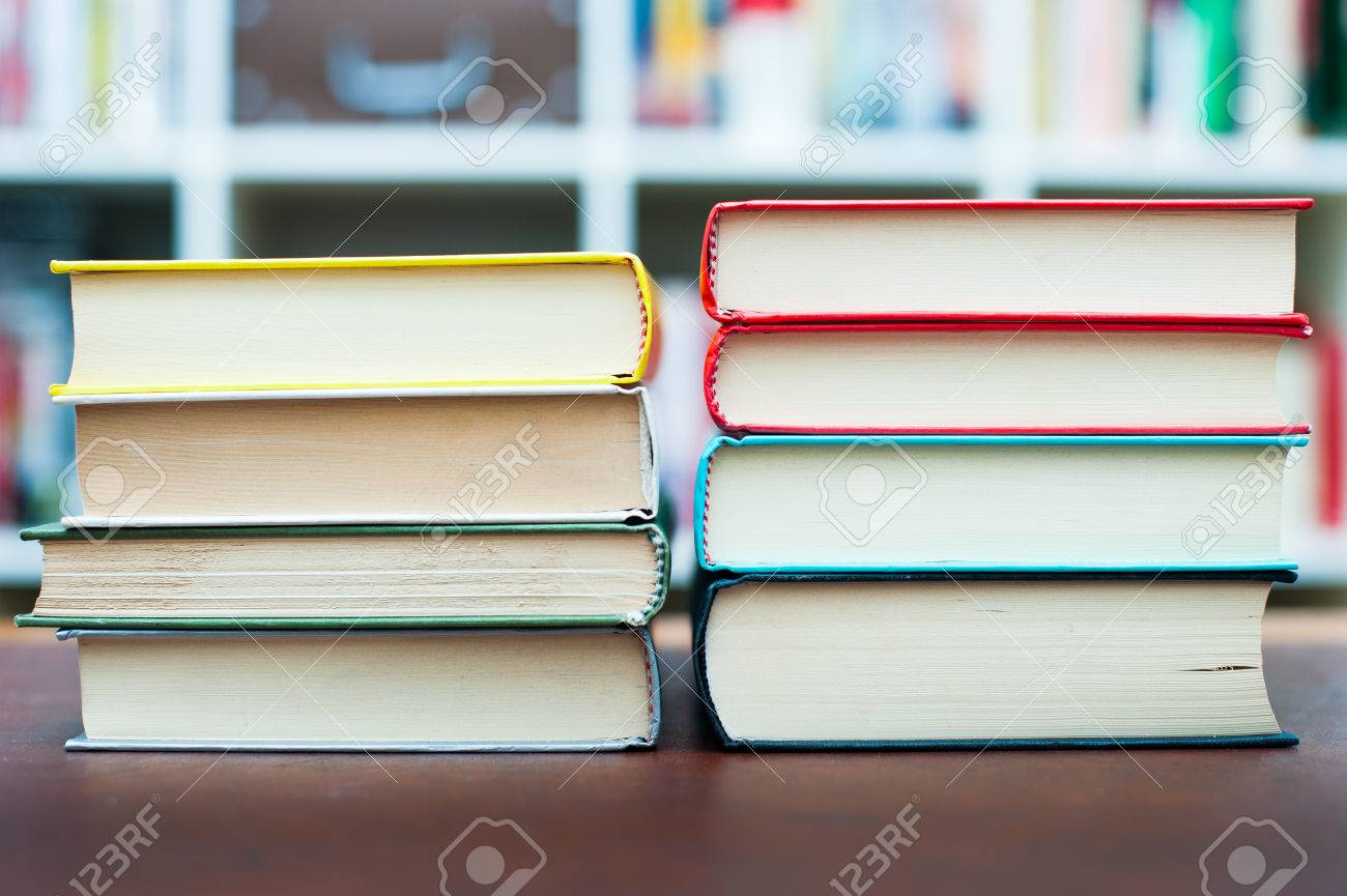 Terrific Two Piles Of Different Colors Books On Desktop With Library Home Interior And Landscaping Ologienasavecom