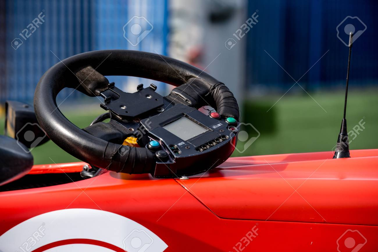 Single seater formula racing car steering wheel out of cockpit
