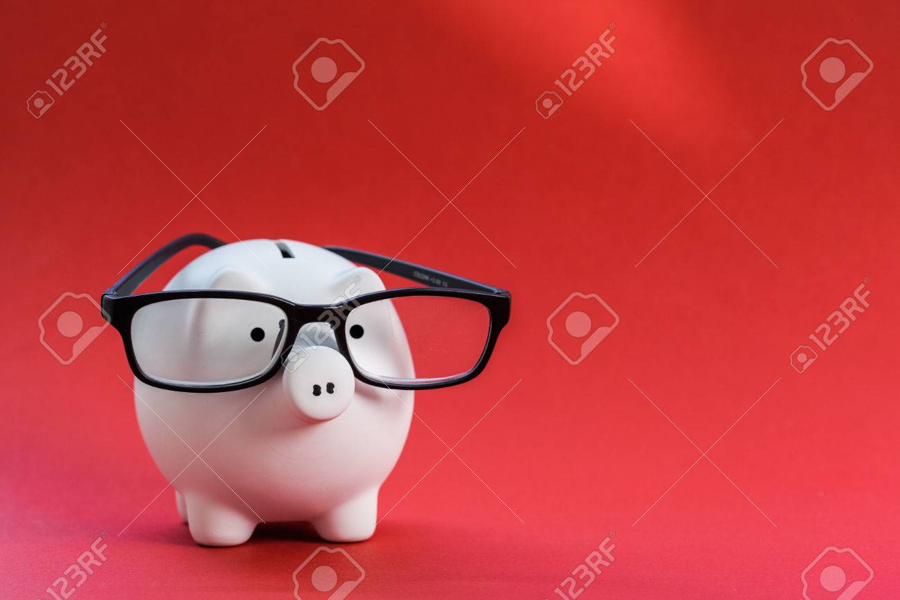 Piggy bank on red background - 77838545