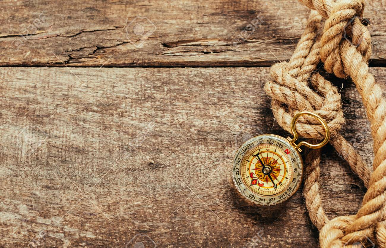 ship ropes and compass on wooden background - 77845988