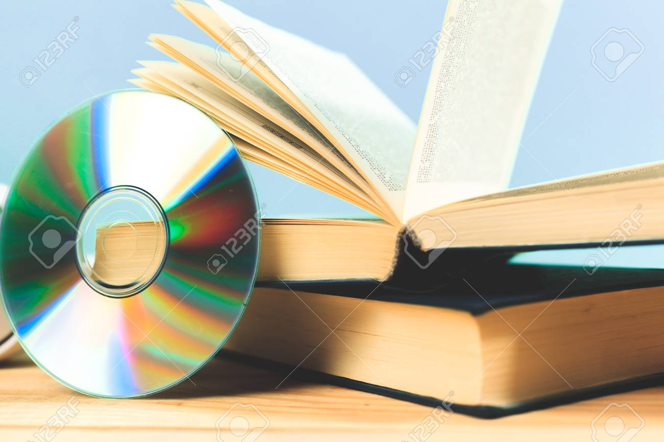 Book and dvd disk as symbols of old and new methods of information book and dvd disk as symbols of old and new methods of information storage stock photo biocorpaavc Images