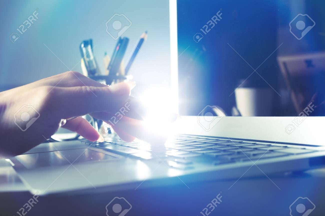 Typing on laptop closeup - 78098212
