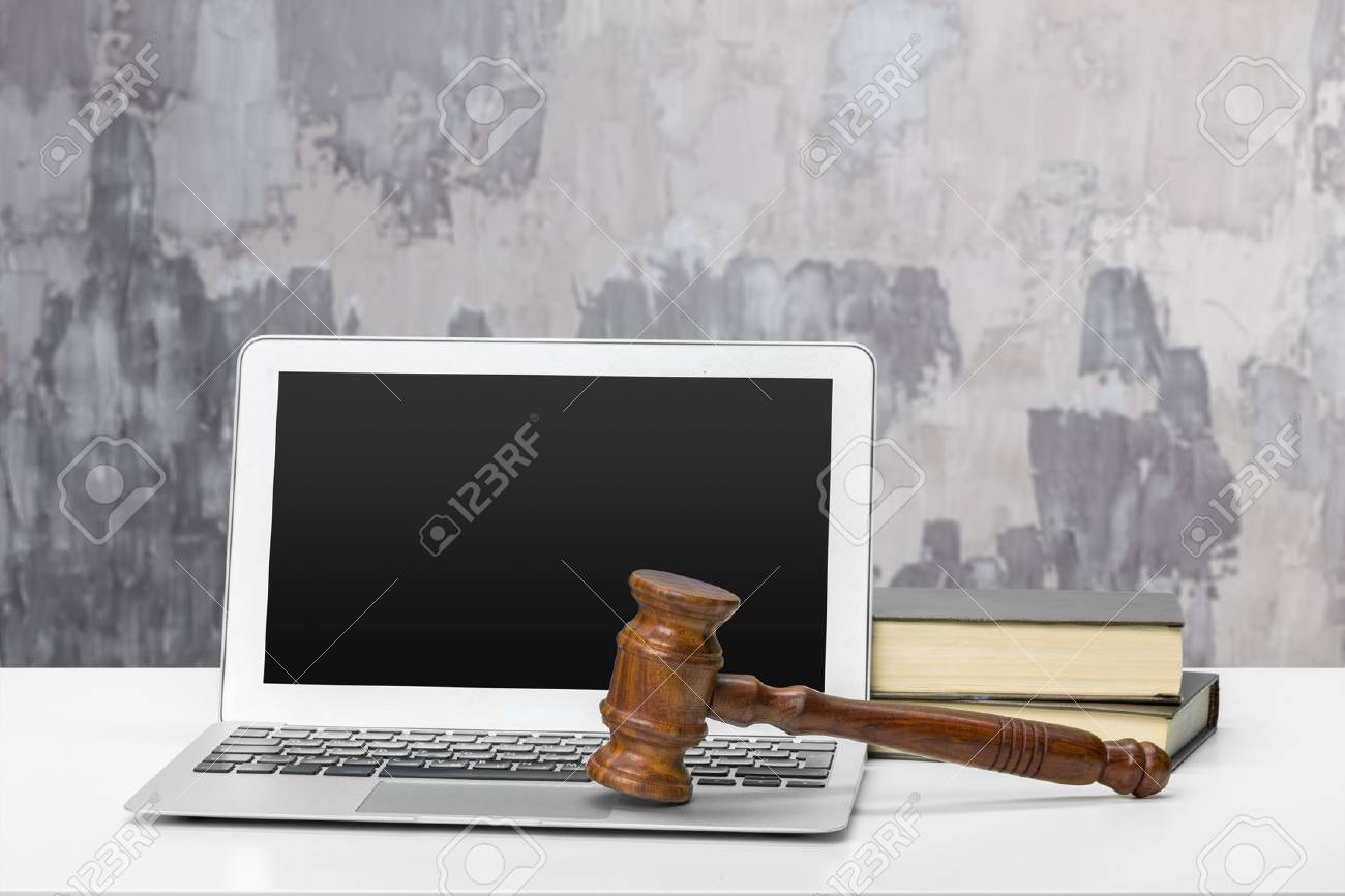 Laptop And Mallet On Table - 78193510