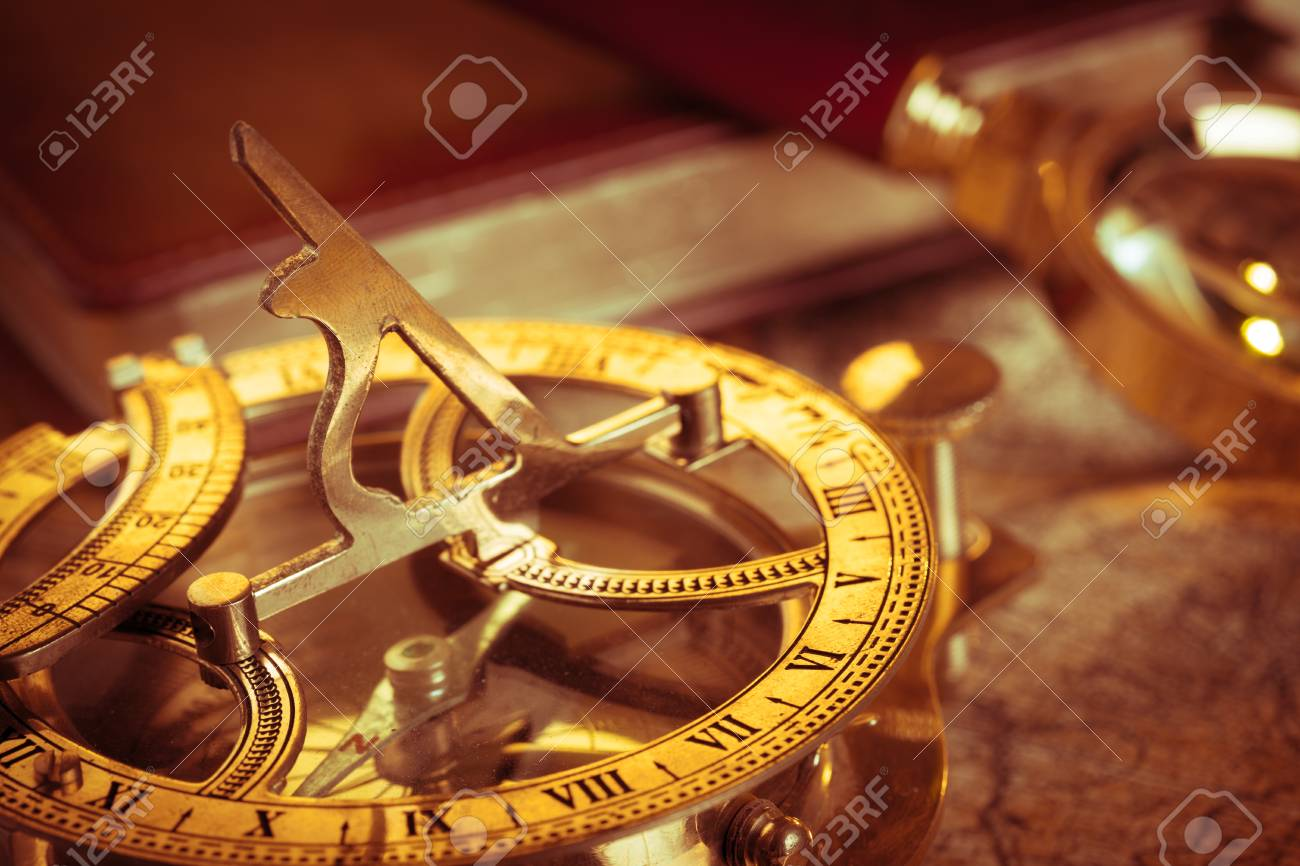 Old vintage compass and travel instruments on ancient map - 79092837