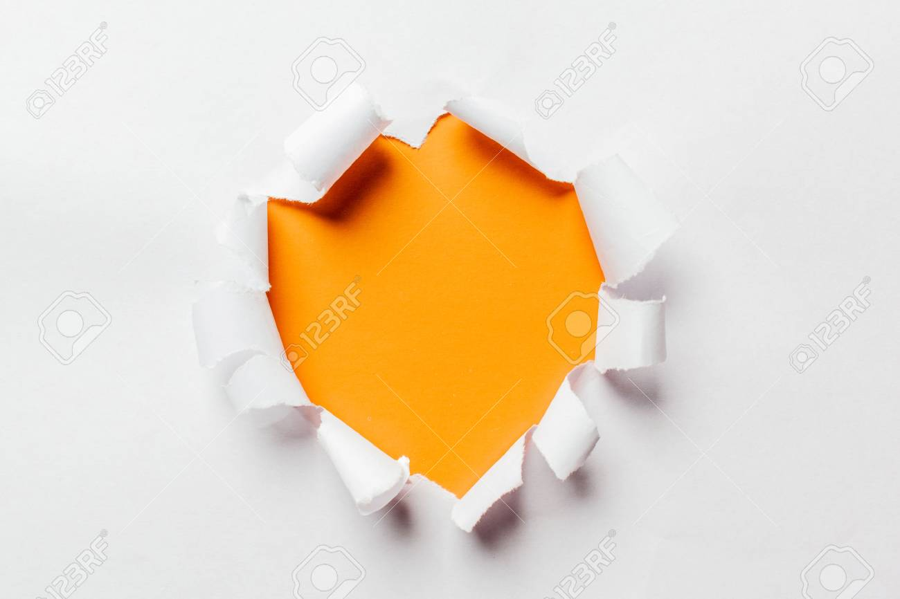 Hole in the paper with torn sides - 79825714