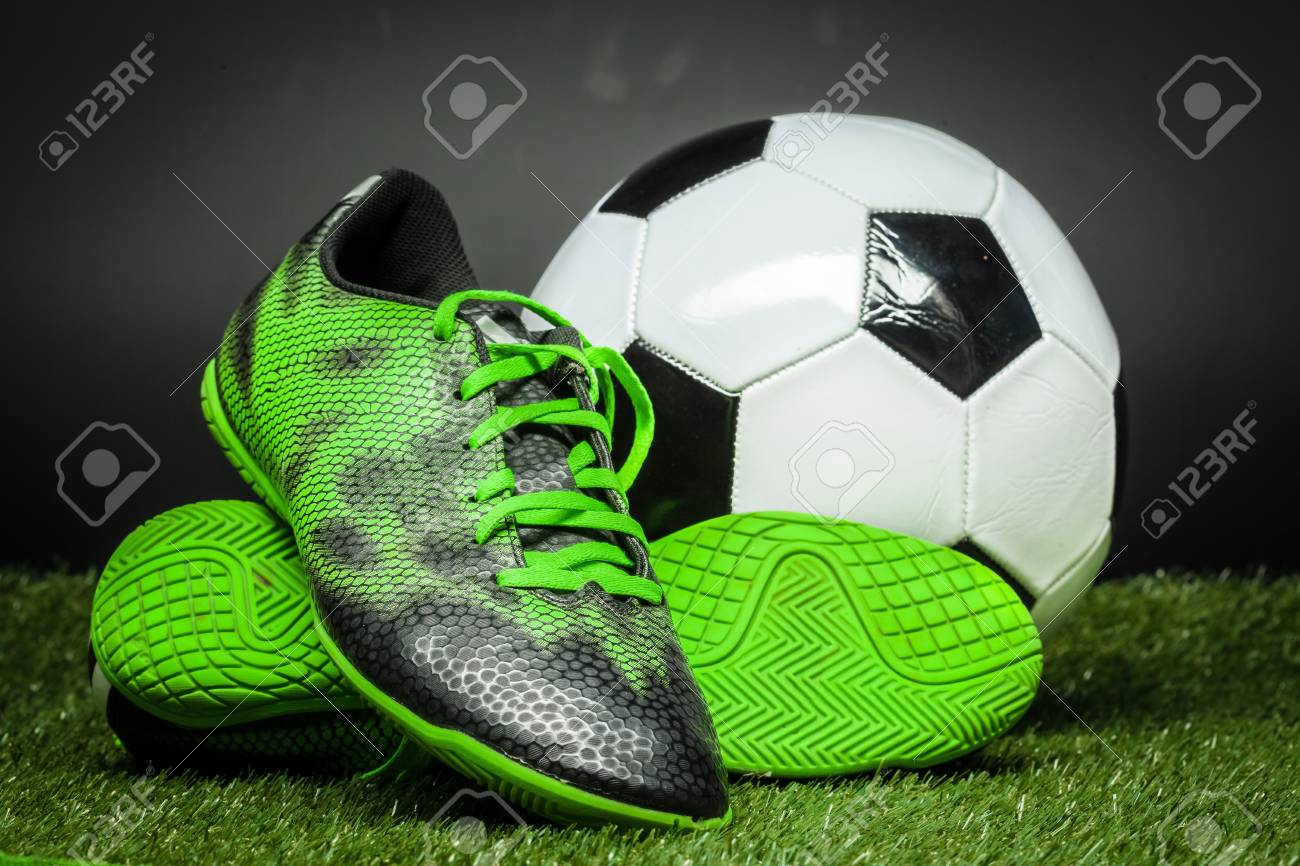 soccer ball and cleats on the football field Stock Photo - 86149747 a8af6d338df60