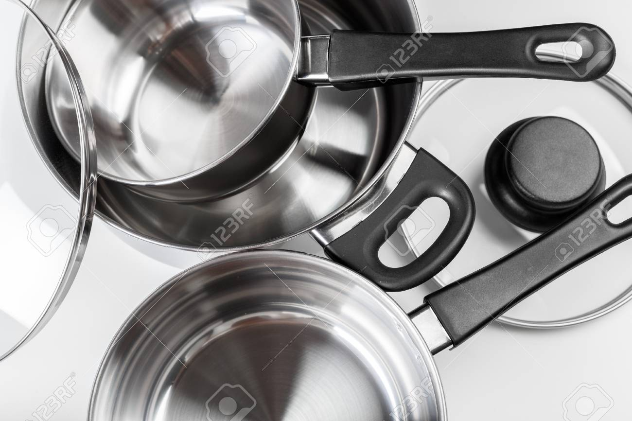 Stainless steel pots and pans isolated on white - 86306395