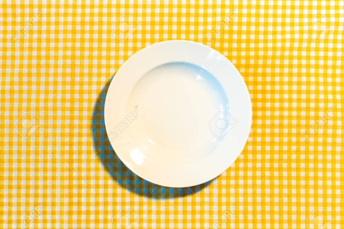 Stock Photo   The Plate On Yellow Checkered Table Cloth
