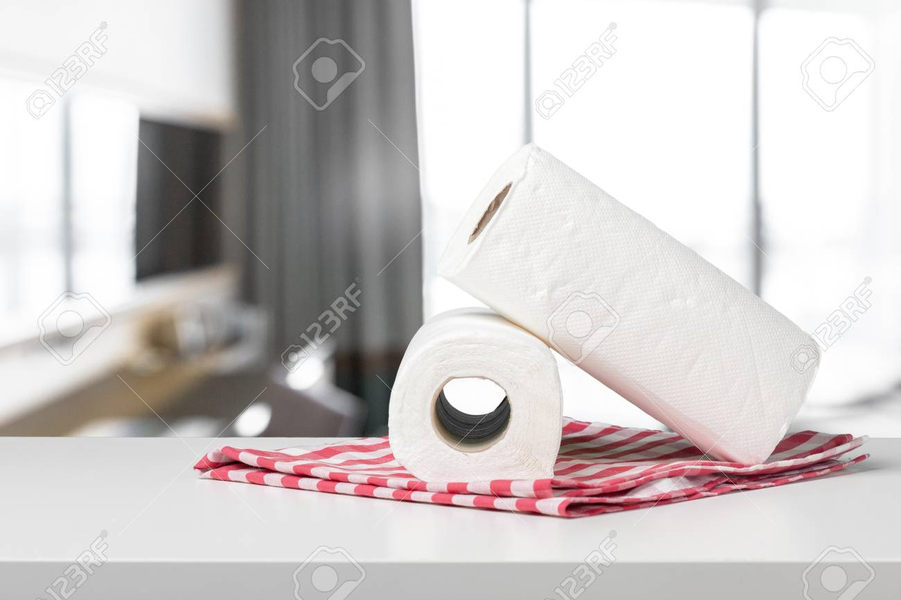 Soft paper towels on a white desk front view - 94357385