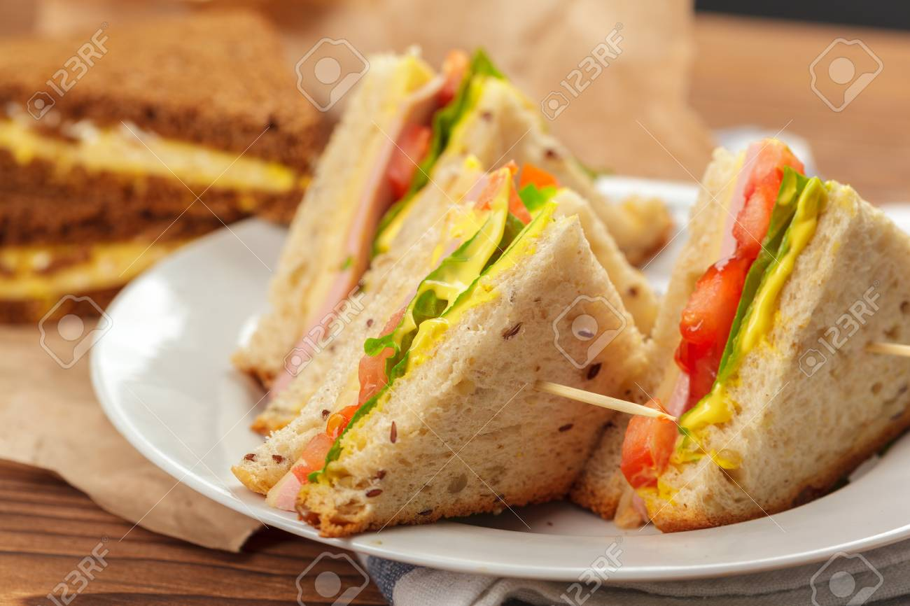 sandwich on a wooden table - 110858779
