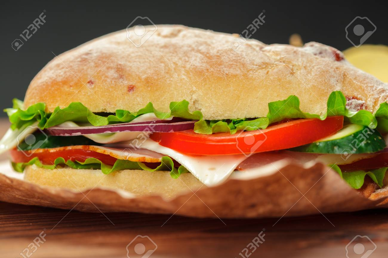 sandwich on a wooden table - 110860642