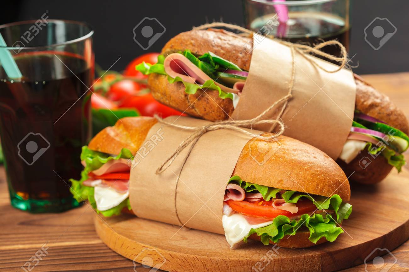 sandwich on a wooden table - 110864463
