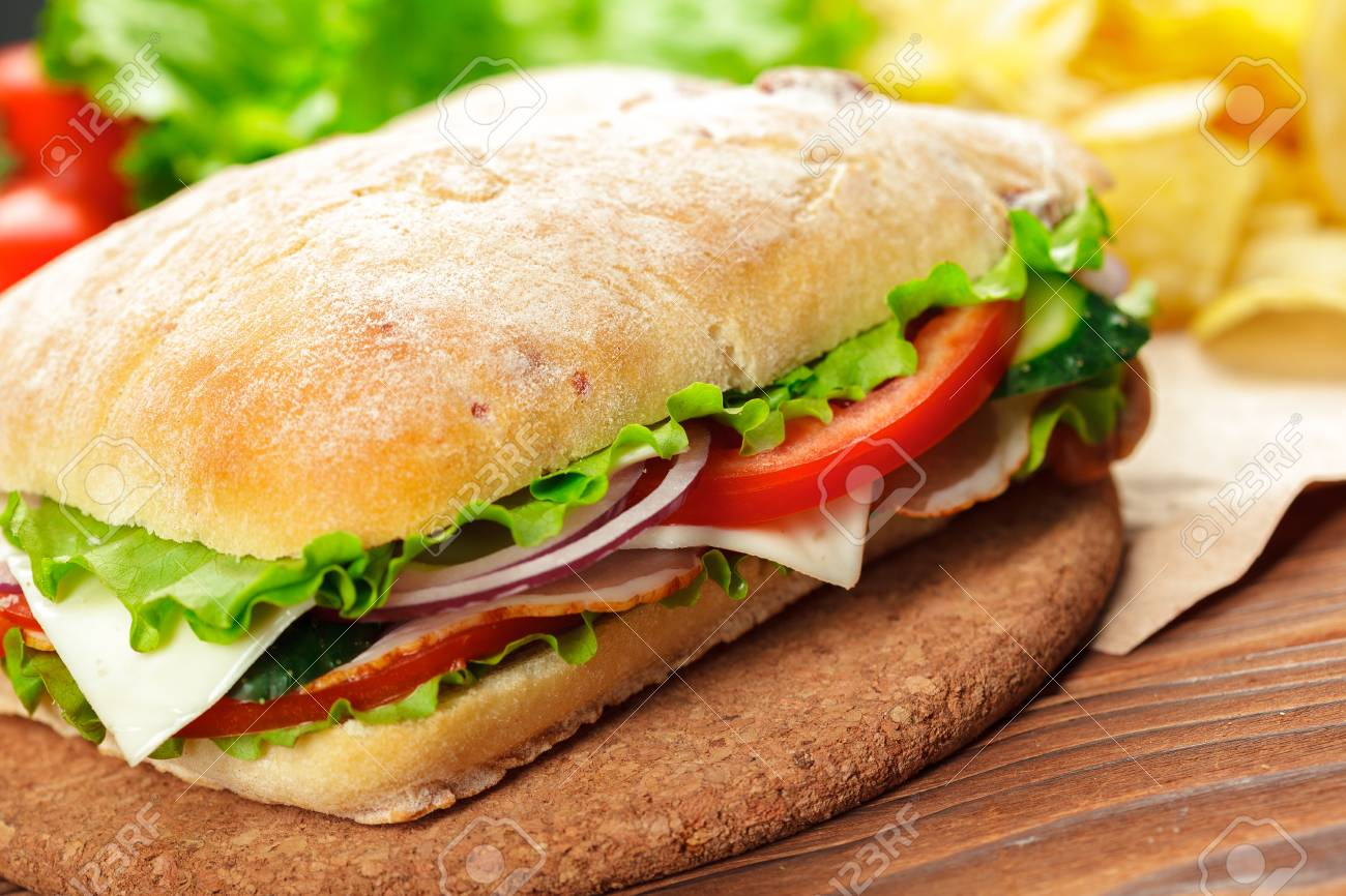 sandwich on a wooden table - 111038925