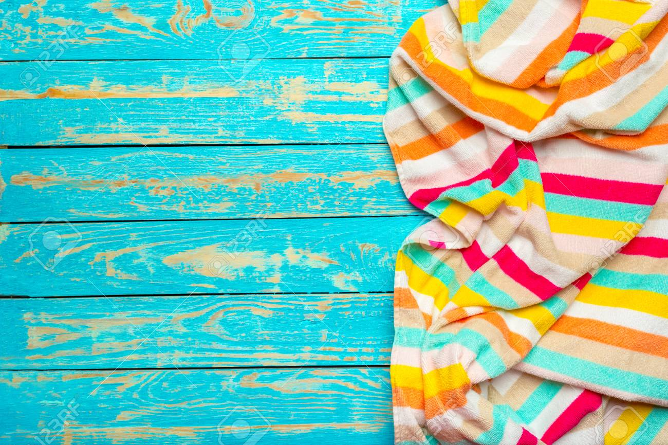 59818a895674 Stock Photo - Summer beach towel on colored background