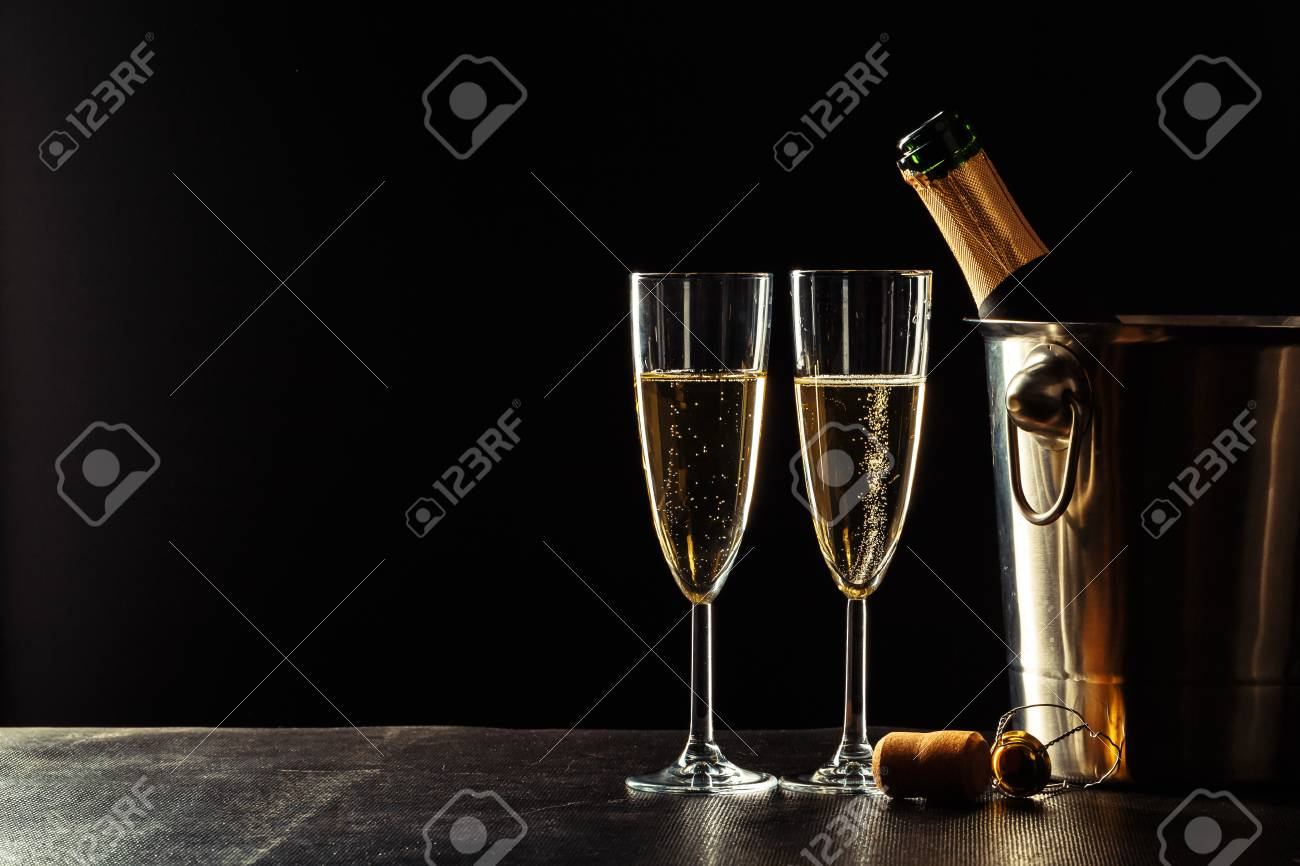 Champagne on the black background - 112957298