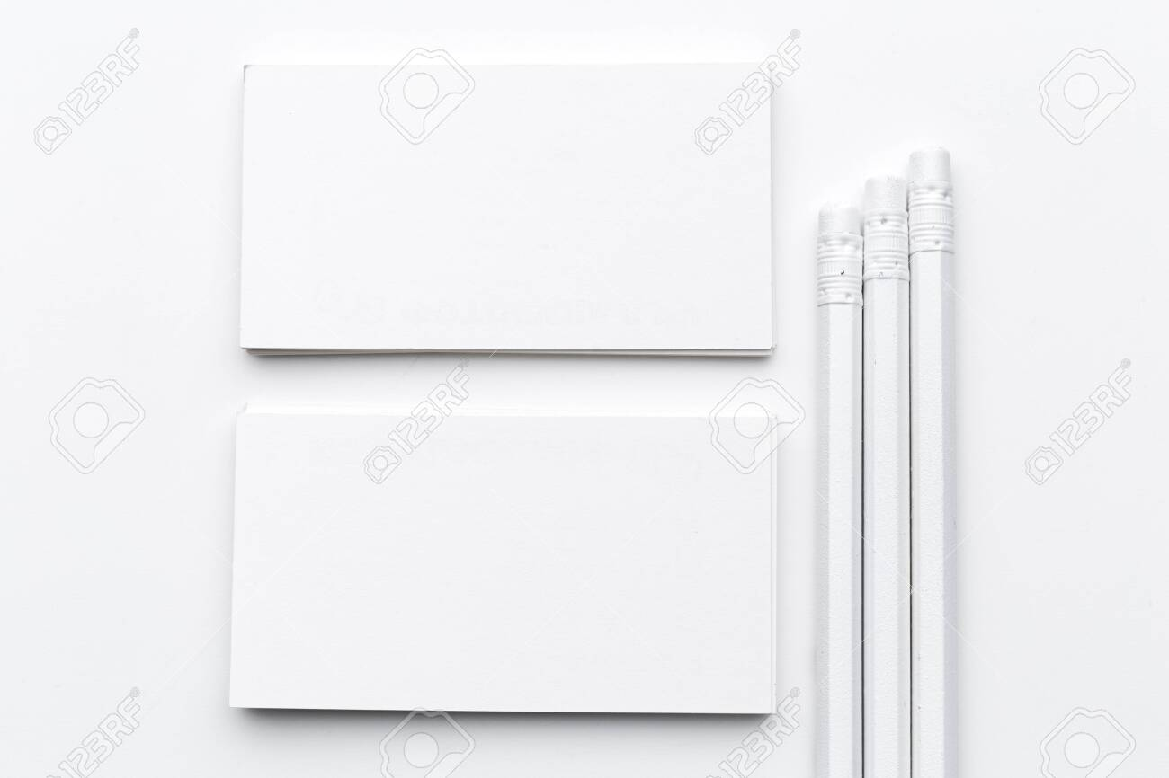 White blank business card. Office table desk with pencil. Top view and copy space for ad text. creative photo. - 141378146