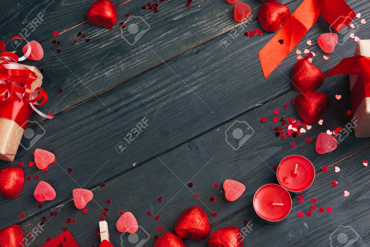 Gift box with red hearts on wooden table. creative photo. - 141378574