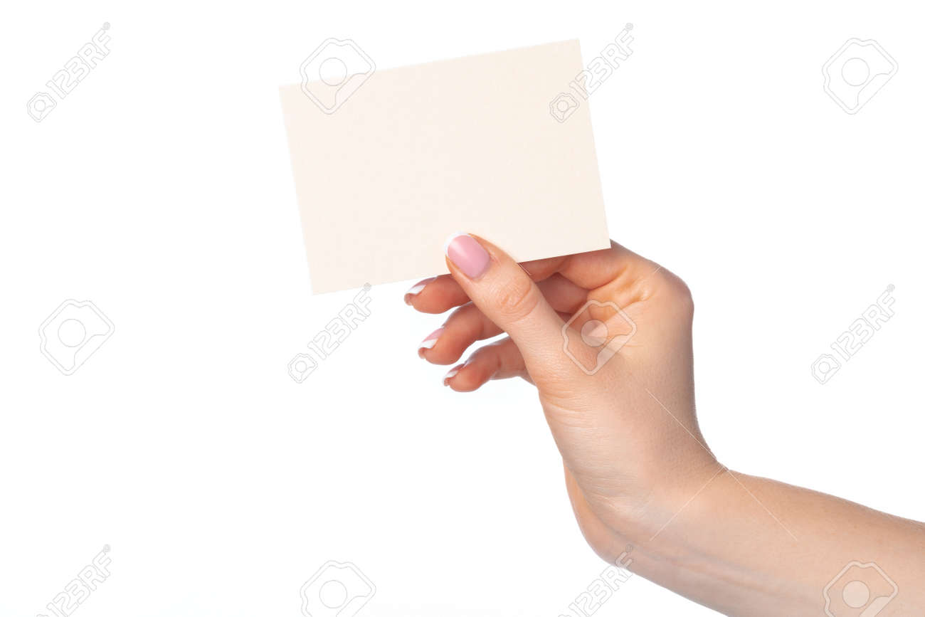 Womans hand with blank white business card isolated on white - 148259870