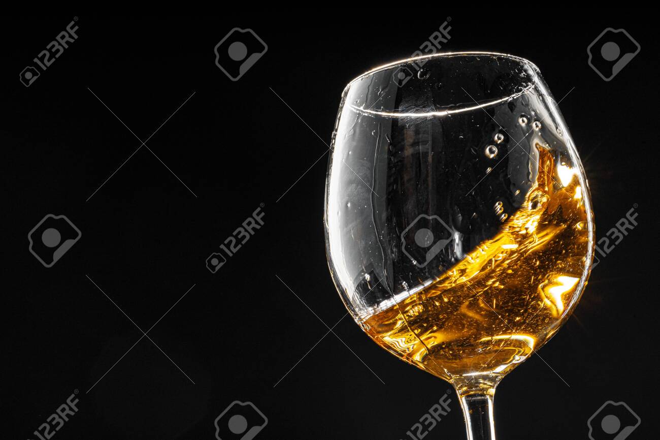 Glass of wine on black background, close up - 150180280
