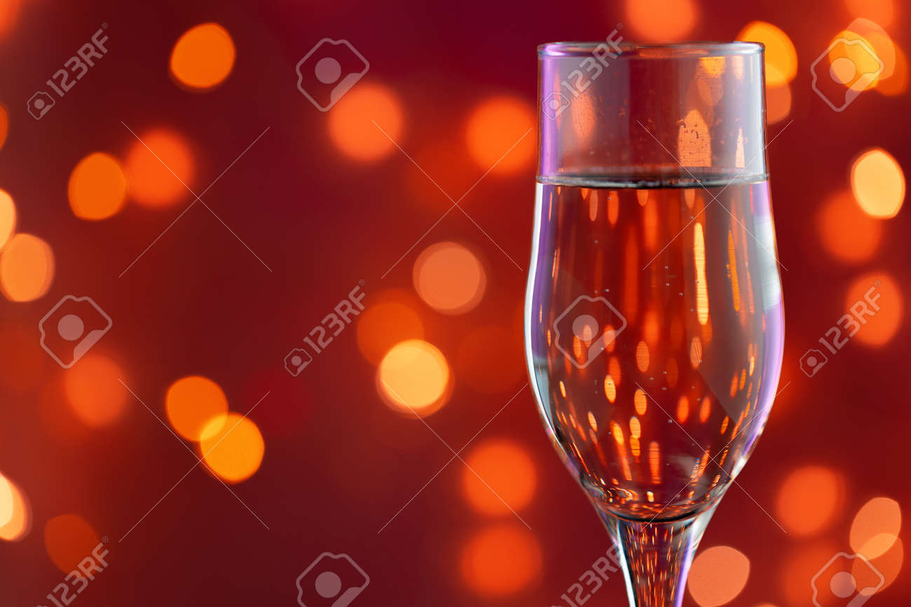 Close up photo of full Champagne glass - 155523926