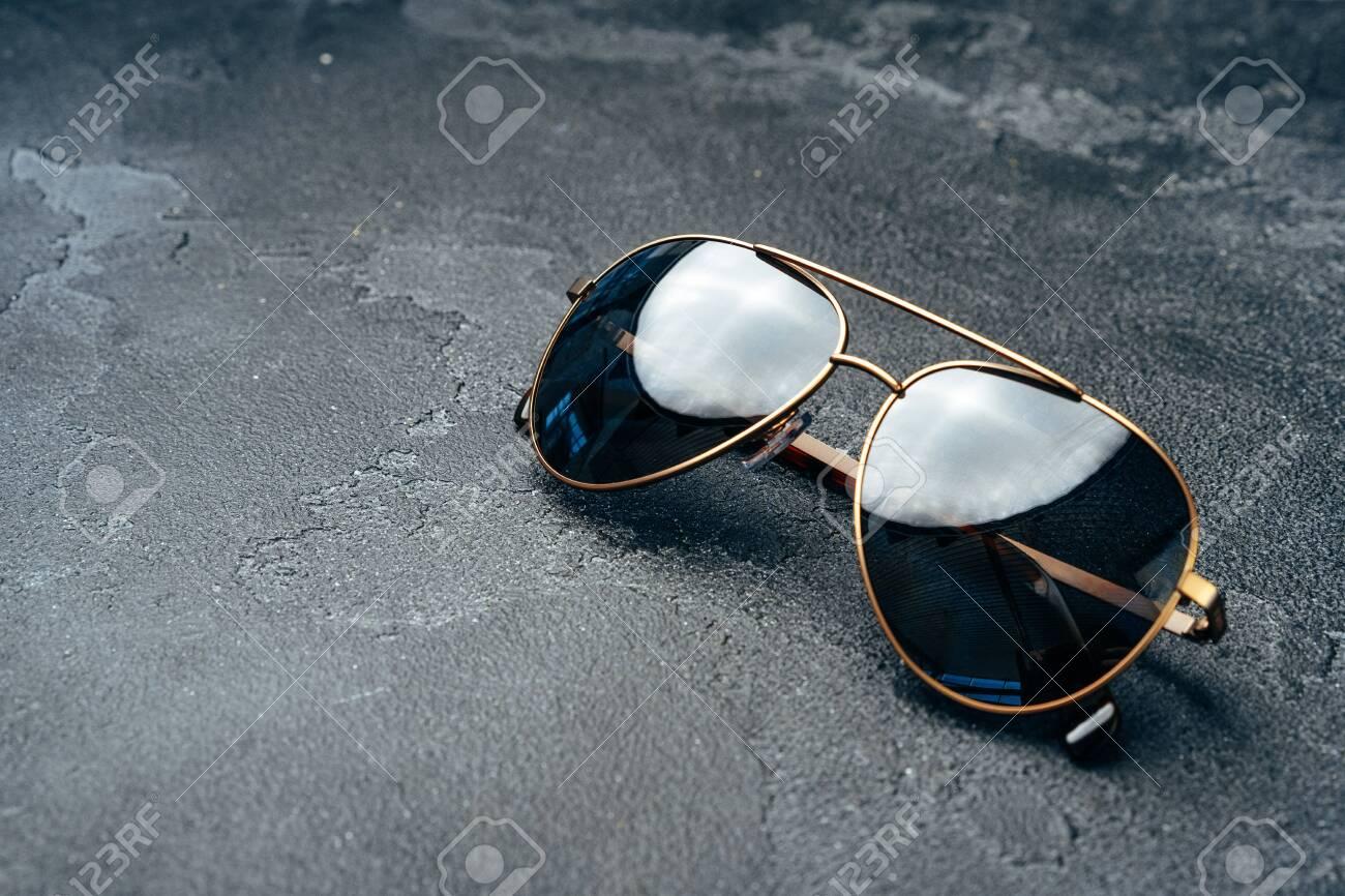New dark aviator glasses on grey concrete background - 155627130