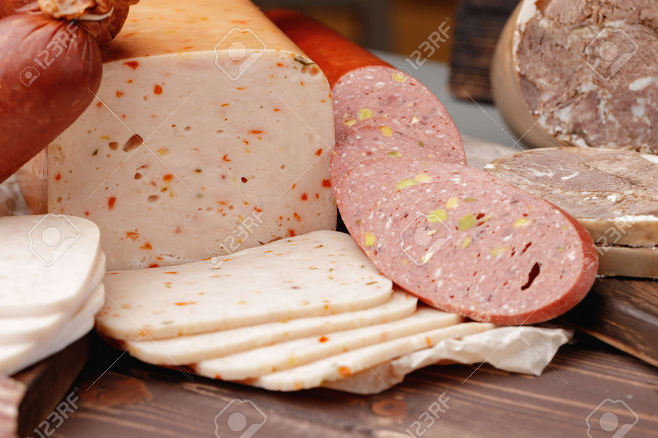 Variety of meat and sausage products on table - 168272084