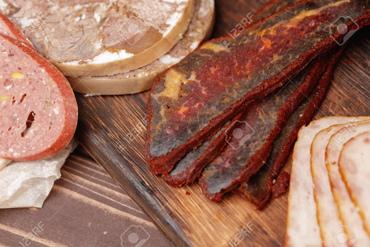 Variety of meat and sausage products on table - 168762302
