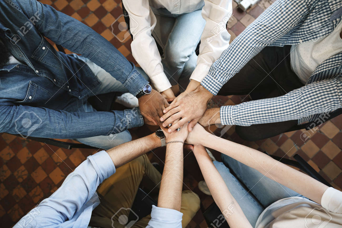 Top view of diverse people hands holding together in circle, hands stack - 169200418